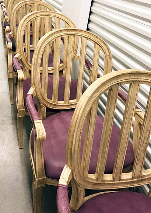 Row of 8 dining chairs